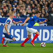 PARIS, FRANCE - March 25:  Benjamin Pavard #2 of France defended by Hordur Bjorgvin Magnusson #18 of Iceland during the France V Iceland, 2020 European Championship Qualifying, Group Stage at  Stade de France on March 25th 2019 in Paris, France (Photo by Tim Clayton/Corbis via Getty Images)