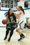 Rice forward Rachel Chicoine (21) drives to the hoop past Mount Mansfield center Breanna Dooling (4) during the girls basketball game between the Rice Green knights and the Mount Mansfield Cougars at MMU High School on Friday night December 4, 2015 in Jericho. (BRIAN JENKINS/for the FREE PRESS)