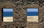 View through windows from the ruin of a gold smelting-works, North Coast Aruba.<br /> Uitzicht door de ramen van de ruine van een goudsmelterij aan de Noord Kust van Aruba.
