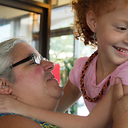 Olivia Johns, 6, teases her great aunt, Chief Sharon Bryant, during dinner in Madison Heights, VA, a community just outside Amherst, VA in September, 2013. The Monacan community is very close, with 3 generations of family often taking care of each other.  Chief Bryant died from cancer in July, 2015.