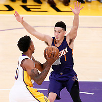 06 November 2016: Los Angeles Lakers guard Nick Young (0) drives by Phoenix Suns guard Devin Booker (1) during the LA Lakers 119-108 victory over the Phoenix Suns, at the Staples Center, Los Angeles, California, USA.