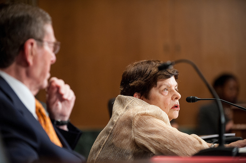 Former Senate Budget Committee Chairman Senator PETE DOMENICI (R-NM) looks on as former White House Budget Director ALICE RIVLIN testifies before a Senate Finance Committee hearing on Capitol Hill Tuesday about the looming fiscal crisis.