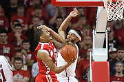 January 20, 2014: Terran Petteway (5) of the Nebraska Cornhuskers goes to block a shot by LaQuinton Ross (10) of the Ohio State Buckeyes and palms his forehead at the Pinnacle Bank Arena, Lincoln, NE. Nebraska won in the game against Ohio State 68 to 62.