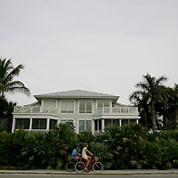 BOCA GRANDE, FL -- January 3, 2008 -- Bicyclists make their way along Gulf Blvd. in Boca Grande, Fla., on Saturday, January 3, 2008.  Boca Grande is a small Old-Florida community on Gasparilla Island, with no traffic lights, billboard or condo development, which attracts both seasonal and year-round affluent residents.