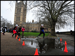 Lord Redesdale Lib Dem takes part in the MP's and Lords race against political Journalist in the Rehab Parliamentary Pancake Shrove Tuesday race a charity event which sees MPs and Lords joined by media types in a race to the finish. Victoria Tower Gardens, Westminster, Tuesday February 12, 2013. Photo By Andrew Parsons / i-Images