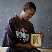 George Obama, the half brother of US presidential hopeful Barack Obama, holds a picture of his father Barack Obama Sr.
