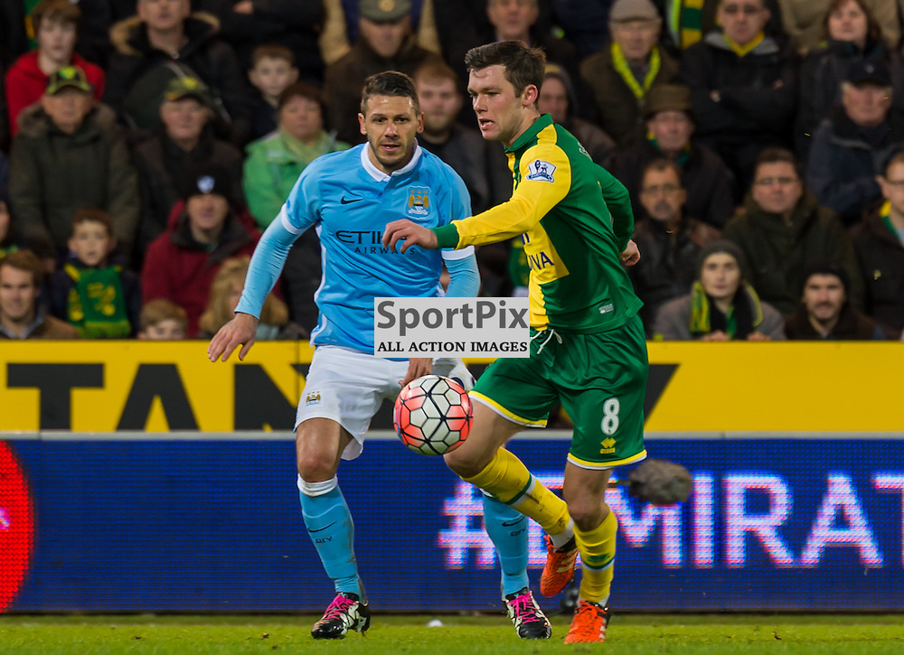 Norwich City midfielder Jonathan Howson (8) gets away from Manchester City defender Martin Demichelis (26)