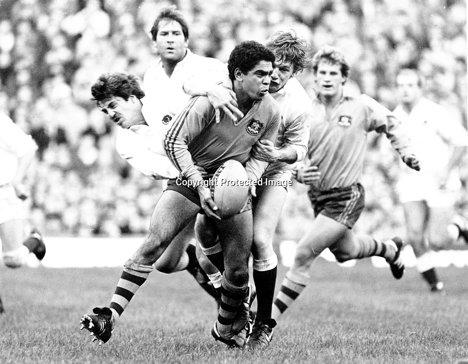 Mark Ella tackled by Stuar Barnes of England. Australian rugby union. 3 November 1984. Photo: PHOTOSPORT