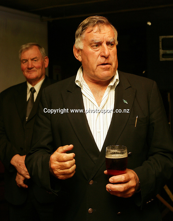 Colin Meads speaks with Sir Brian Lochore behind at the launch of the AA Rewards Heartland Championship at the Muddy Farmer Pub, Auckland, New Zealand on Friday 18 August, 2006. Photo: Hannah Johnston/PHOTOSPORT