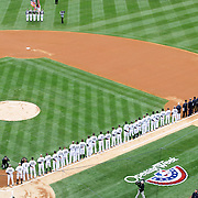 New York Yankees players line up on the first base line during the opening ceremony during the New York Yankees V Baltimore Orioles home opening day at Yankee Stadium, The Bronx, New York. 7th April 2014. Photo Tim Clayton