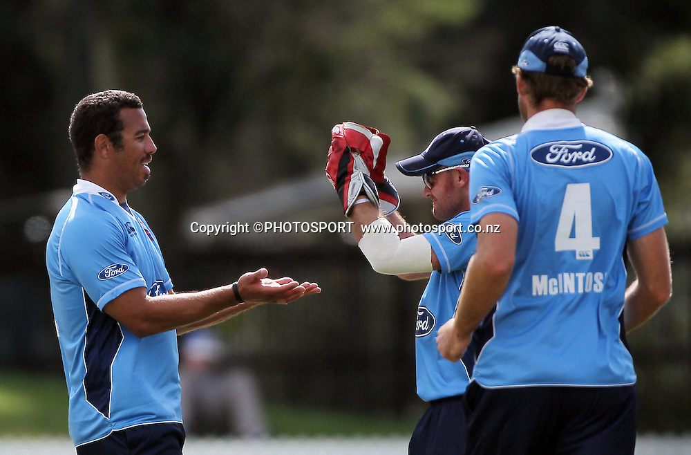 Andre Adams and Gareth Hopkins celebrate the wicket of Grant Elliott. Auckland Aces v Wellington Firebirds,   Ford Trophy one day game held at Burt Sutcliffe Oval, Lincoln, Friday 25 November 2011. Photo : Joseph Johnson / photosport.co.nz