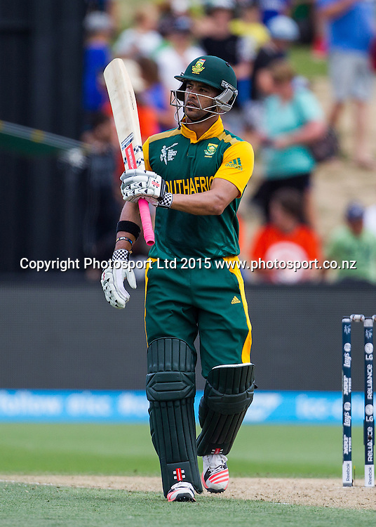 South Africa's JP Duminy raises his bat to the crowd after reaching his 50 during the ICC Cricket World Cup match - South Africa v Zimbabwe at Seddon Park, Hamilton, New Zealand on Sunday 15 February 2015.  Photo:  Bruce Lim / www.photosport.co.nz