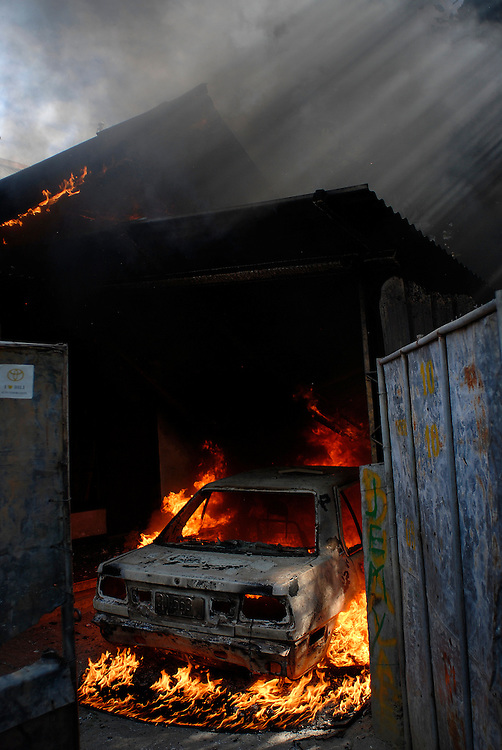 Another house and its belongings goes up in flames as violence continues to plague Dili as continual clashes erupt between Easterners ( Lorosae) and Westerners (Loromonu) in Dili. 080606