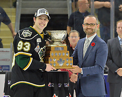 Milos Vranesevic, VP, Head of Marketing MasterCard Canada presents the Stafford Smythe Memorial Trophy to Mitch Marner of the London Knights. Photo by Terry Wilson / CHL Images.
