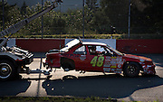 A driver is towed into the pits after losing his back wheel during the Saturday night races at Agassiz Speedway in Agassiz, BC (2012)