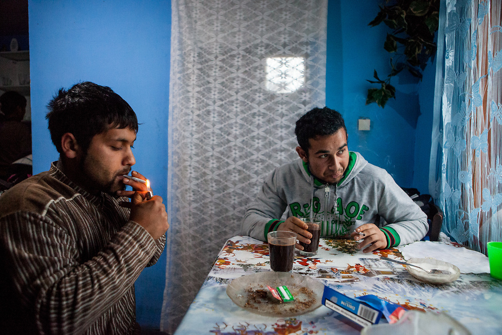 Michal (22) and Emil (20) having a coffee and cigarettes in the new house of Emil in Rankovce where the foundation ETP Slovakia has a project setting up micro-loan funds for the local Roma community. Loans from this fund will enable families to build their own low-cost brick homes, on land they own.