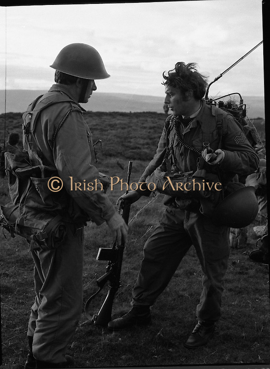 "Army Exercises In Co Sligo.   (L37).<br /> 1977.<br /> 05.09.1977.<br /> 09.05.1977.<br /> 5th September 1977.<br /> The Army Reserve Brigade, which is made up of regular units from the Southern Command, are conducting a series of conventional military exercises in counties Mayo and Sligo from the 5th to the 9th September. Approximately 1,500 men and 250 vehicles are involved. The exercise was codenamed ""Humbert"" after an ill fated expedition by French troops into Ireland on 23rd August 1798. 1,100 French troops with Irish support took on the incumbent English forces. After some initial success they were defeated at Ballinamuk on 8th Sept 1798 by the army of Cornwallis.<br /> <br /> An image of Comdt Patrick Kelly issuing instructions to Signalman John Buckley."