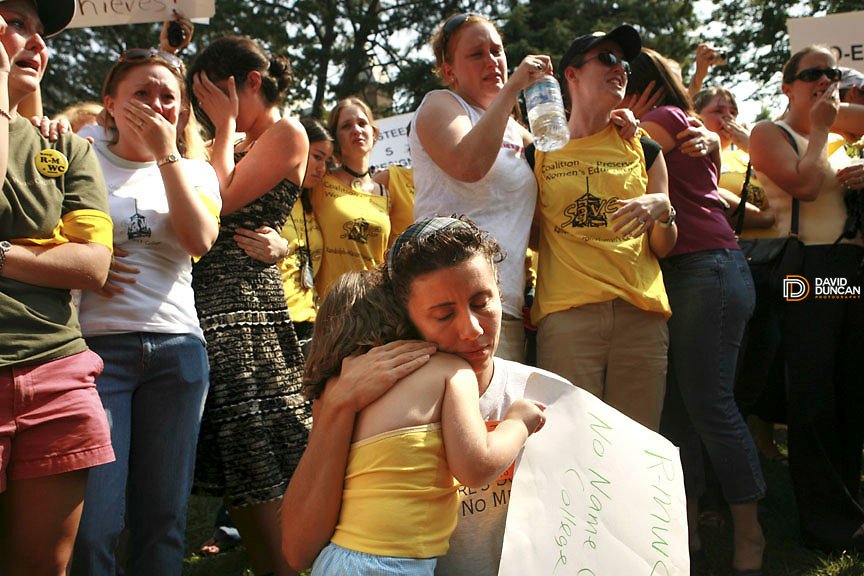 Alumnae Tina Finical from Jacksonville, Fl holds her daughter, Hannah, as Students and alumnae's react after the Jolley Christman, President of the Board of Trustees at Randolph-Macon Woman's College announced Saturday August 9, 2006 at 11:18am in Lynchburg, VA that the all woman's college would admit men in 2007..Photo by David Duncan.