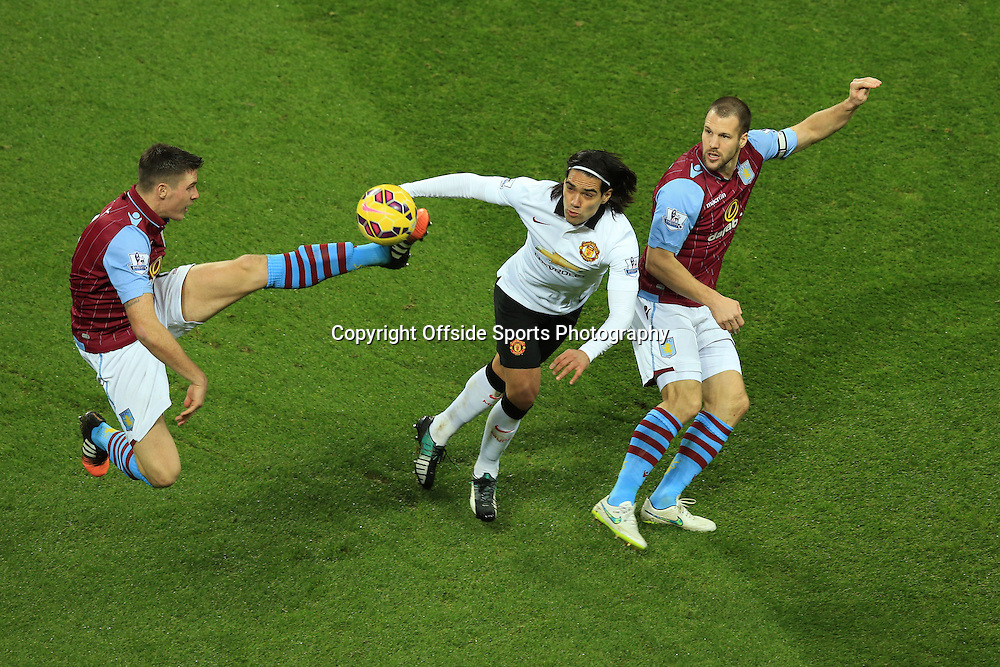 20 December 2014 - Barclays Premier League - Aston Villa v Manchester United - Radamel Falcao of Manchester United in action with Ciaran Clark (L) and Ron Vlaar of Aston Villa - Photo: Marc Atkins / Offside.