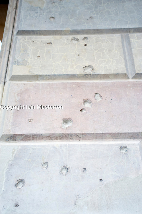 Bullet holes from World War 2 remain in the exterior wall of renovated and recently reopened Neues Museum in Berlin 2009 Architect David Chipperfield