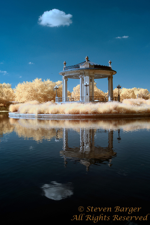 Infrared image featuring the Nathan Frank Bandstand  reflected in Pagoda Lake St. Louis Missouri
