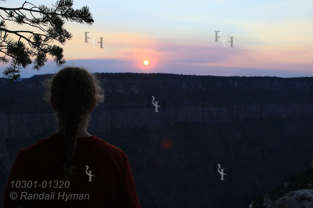 Visitors enjoy sunrise and sunset from Bright Angel Point, North Rim, Grand Canyon National Park, Arizona.