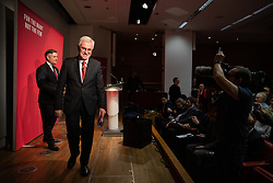© Licensed to London News Pictures. 13/11/2019. London, UK. Shadow Chancellor of the Exchequer John McDonnell MP leaves the stage, (Shadow Secretary of State for Health and Social Care John Ashworth MP in the background) after making a speech at The Royal Society of Medicine to announce labour's plan for health and the NHS. Photo credit : Tom Nicholson/LNP