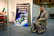 An Iranian motorcycle safety concept is demonstrated by an entrepreneur at an inventors fair in Alexandra Palace, London