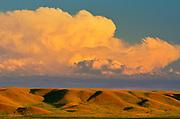 Clouds at sunset over prairie landscape. Western Block, Grasslands National Park, Saskatchewan, Canada