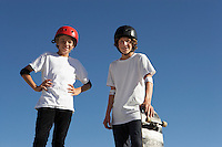 Two teenage male skateboarders (16-17) outdoors portrait