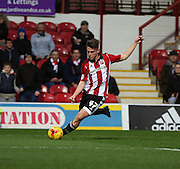 Brentford midfielder Sergi Canos crossing the ball during the Sky Bet Championship match between Brentford and Milton Keynes Dons at Griffin Park, London, England on 5 December 2015. Photo by Matthew Redman.