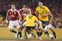 MELBOURNE, 29 JUNE - Dan LYDIATE of the Lions is tackled by Christian LEALI'IFANO of the Wallabies during the Second Test match between the Australian Wallabies and the British & Irish Lions at Etihad Stadium on 29 June 2013 in Melbourne, Australia. (Photo Sydney Low / asteriskimages.com)