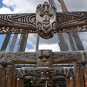 The carved contemporary entrance to Te Puia, Rotorua. Te Puia is the premier Maori cultural centre in New Zealand - a place of gushing waters, steaming vents, boiling mud pools and spectacular geysers. Te Puia also hosts National Carving and Weaving Schools and  daily maori culture performances including dancing and singing. Rotorua, 9th December 2010 New Zealand.  Photo Tim Clayton