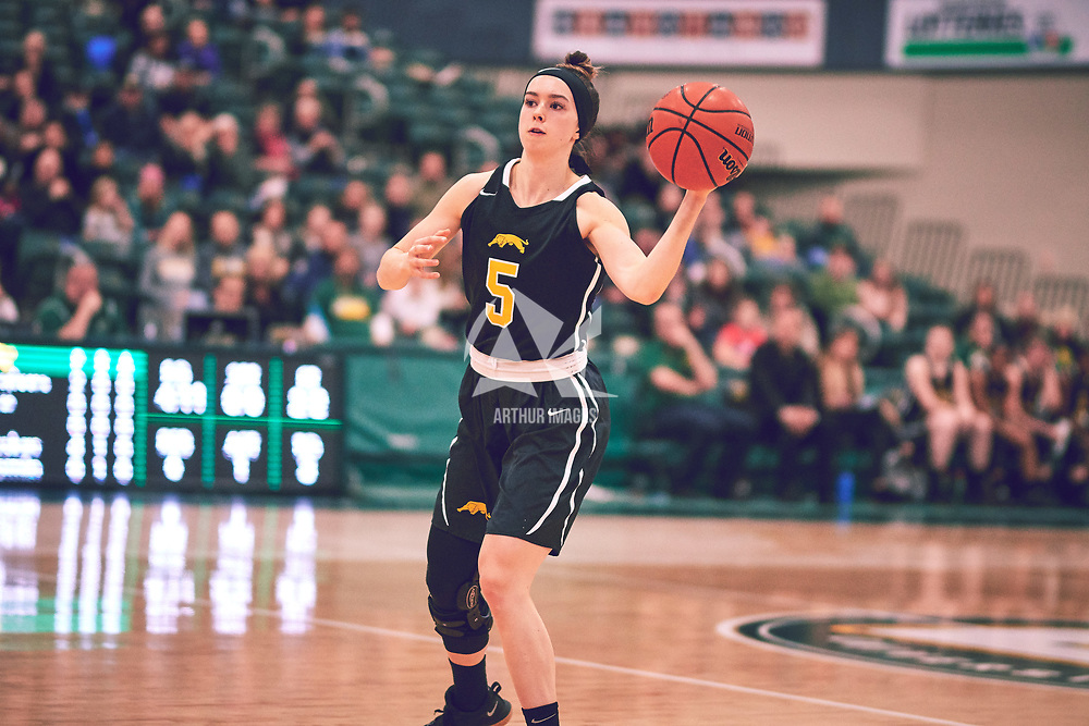 2nd year guard, Faith Reid (13) of the Regina Cougars during the Women's Basketball Home Game on Fri Feb 15 at Centre for Kinesiology,Health and Sport. Credit: Arthur Ward/Arthur Images