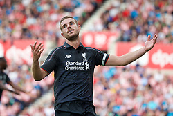 STOKE-ON-TRENT, ENGLAND - Sunday, August 9, 2015: Liverpool's captain Jordan Henderson looks dejected after a miss against Stoke City during the Premier League match at the Britannia Stadium. (Pic by David Rawcliffe/Propaganda)