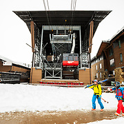 Crystal Wright (L) and Eva Walkner walk below the tram dock for another afternoon ski run.