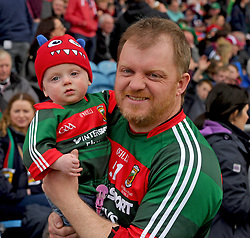 Mayo supporters from Bonniconlon 1yr old Luke Gillard with his dad Donal at McHale park on sunday last.<br />