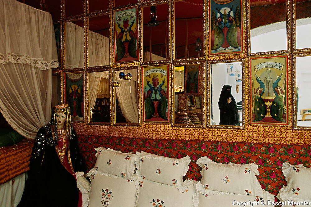 QATAR. Doha. House of the Tradition...Not to forget their Bedouin origins, the government made a point of opening a House of the Tradition. Inside, a typical room, clothing. Every day, women make traditional objects..