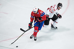 Thomas Valkvae Olsen of Norway vs Denis Hollenstein of Switzerland during the 2017 IIHF Men's World Championship group B Ice hockey match between National Teams of Norway and Switzerland, on May 7, 2017 in Accorhotels Arena in Paris, France. Photo by Vid Ponikvar / Sportida