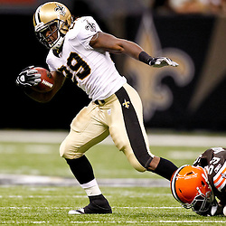 Oct 24, 2010; New Orleans, LA, USA; New Orleans Saints running back Chris Ivory (29) breaks away from Cleveland Browns linebacker Matt Roth (53)during the first half at the Louisiana Superdome. Mandatory Credit: Derick E. Hingle