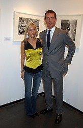 ALEXANDRA VON FURSTENBURG who is separated from her husband Austrian Prince Alexander von Furstenberg and TIM JEFFERIES at a party to celebrate the opening of an exhibition of photographs by the late Norman Parkinson held at Hamiltons gallery, 13 Carlos Place, London W1 on 14th September 2004.<br />