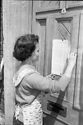 16/06/1963.06/16/1963.16 June 1963.Mrs Keogh, No.6 Hendrick Street reads the condemned notice of her home.