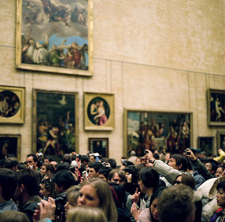Tourists swarm around the Mona Lisa painting trying to take pictures and catch a glimpse of the Leonardo Da Vinci painting at the Louvre Museum in Paris, France.<br /> <br /> NOTE: Larger resolution versions of these images are available on request.