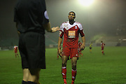 Whitehawk striker Danny Mills argues with linesman during the The FA Cup 2nd Round Replay match between Whitehawk FC and Dagenham and Redbridge at the Enclosed Ground, Whitehawk, United Kingdom on 16 December 2015. Photo by Phil Duncan.