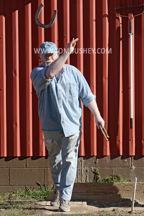 Chatham, NY - Ted Miner tosses horseshoes outside the Chatham Bowl on Nov. 21, 2008.