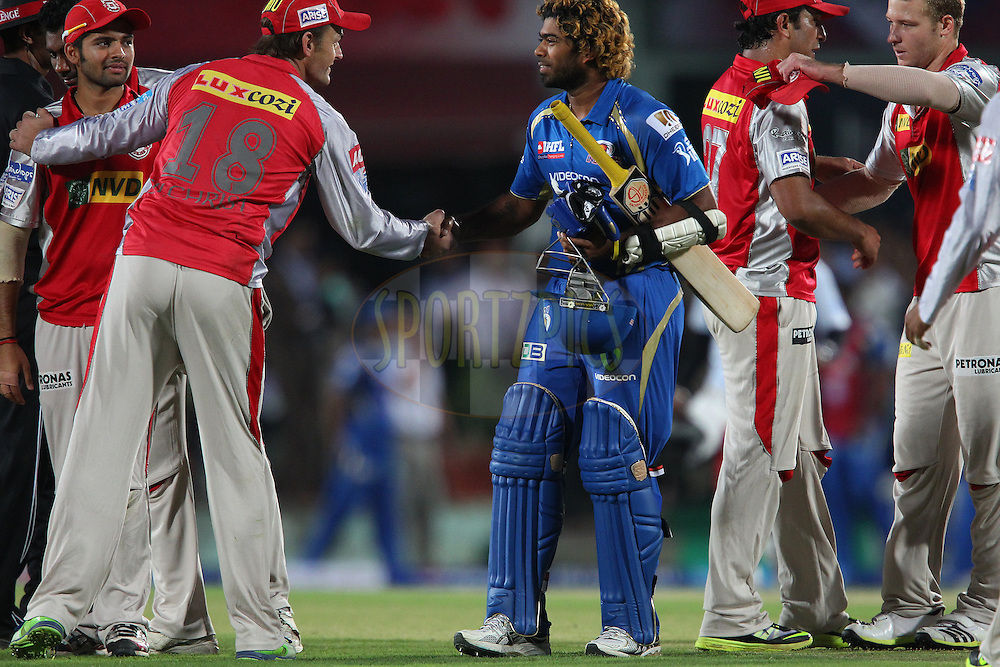 Lasith Malinga congratulates Adam Gilchrist during match 69 of the Pepsi Indian Premier League between The Kings XI Punjab and the Mumbai Indians held at the HPCA Stadium in Dharamsala, Himachal Pradesh, India on the on the 18th May 2013..Photo by Ron Gaunt-IPL-SPORTZPICS ..Use of this image is subject to the terms and conditions as outlined by the BCCI. These terms can be found by following this link:..http://www.sportzpics.co.za/image/I0000SoRagM2cIEc