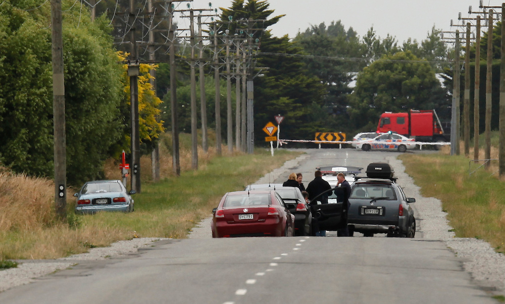 Police at Grey's Road where a body is believed to have been found in a car, Christchurch, New Zealand, Friday, January 6, 2012.  Credit:SNPA / Pam Johnson .