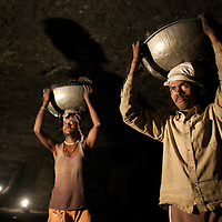 Illegal mining by Adivasi (tribal) communities at the Babupara mine in Hazaribagh District. Families work together to collect coal and produce coke by burning the coal. This piece work is dangerous and unregulated. The coal is mined from the land beneath which the family teams work...Photo: Tom Pietrasik.Jharkhand, India.January 28th 2010