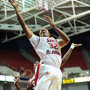 South Alabama's forward Javier Carter (32) shoots a layup in the first half of play in Mobile, AL. Denver leads South Alabama 30-24 at halftime on January 7, 2012..