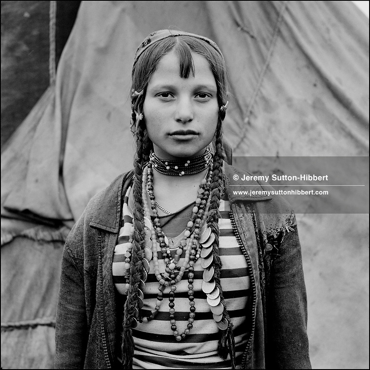 Gina, a Kalderash Roma girl from Baltaeni camp. The wearing of a headscarf shows that she is married..April 1993